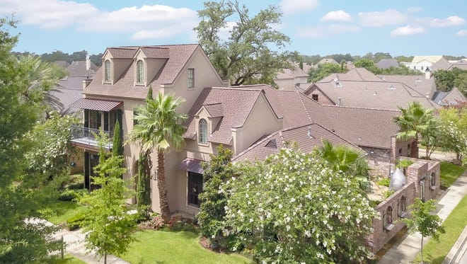 This five 5 bedroom, 5 1/2 bath home is located at200 Ravenswood Lane in River Ranch. It is listed at $1,250,000.