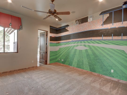 One of the bedroom's in Damion Easley's home features a mural of Tigers Stadium, where he played for the Detroit Tigers.