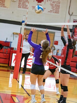 Pickford's Lizzie Storey sets during an Eastern UP Conference match at DeTour.