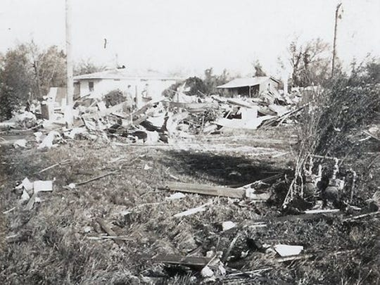 Debris is shown in Kilbourne after a tornado swept through on March 20, 1976.