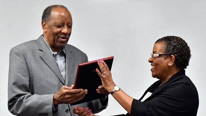 Carl Hilton, left, a former DuPont chemical plant environmental manager who later went on to run the West Jefferson Count Community Task Force, is recognized by Arnita Gadson, former executive director of the West Louisville Community Task Force, for his work in assisting west Louisville neighborhoods with pollution concerns. Tuesday, Feb. 21, 2017