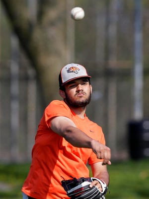 Pitcher Antonio Valadez warms up during a Milwaukee Riverside practice.