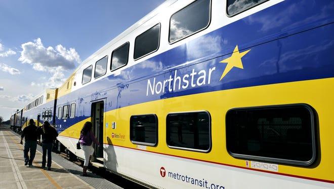 Passengers board a Northstar train at the Big Lake station.