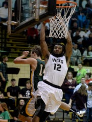 Winchester's Kiante Enis dunks the ball against Northeastern's