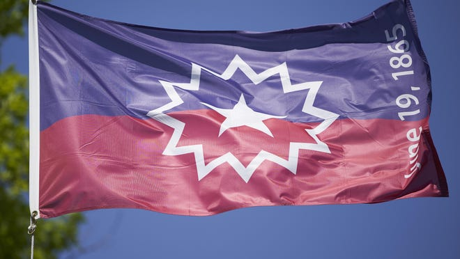 The Juneteenth flag flies in Omaha, Neb., Wednesday, June 17, 2020.