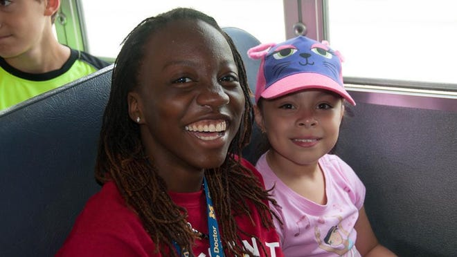 Tolu Igun volunteers with Summer in the City because she has fun helping people and putting smiles on their faces.