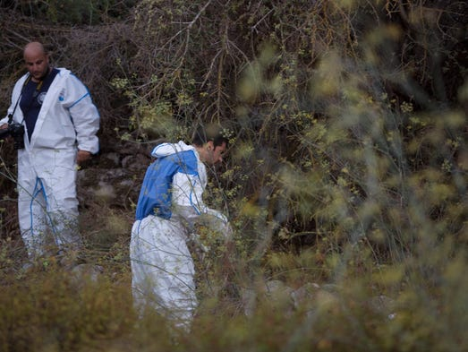 "Israeli police forensic experts work at the  scene where a body was found in a Jerusalem forest, Thursday, Aug. 28, 2014.  Israeli police said Thursday ""there is a strong possibility"" they have found the body of the American seminary student who disappeared while hiking in Jerusalem last week.  Police spokesman Micky Rosenfeld said the body was found in the same area where Aaron Sofer disappeared. Sofer, 23, of Lakewood, New Jersey, had been hiking with a friend in a hilly, forested area on the outskirts of Jerusalem."
