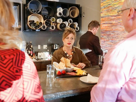 Cellar + Plate owner Mary Guccione talks with customers not long after the wine bar opened. It is among a dozen restaurants teaming up for The Last Straw, a voluntary effort to reduce or eliminate the use of disposable plastics.