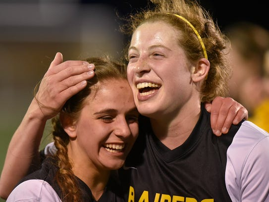 Gabriela Sgambati (right) celebrates her tying goal with teammate Ava Farquhar during the final minutes of the recent city championship game against district rival Farmington.