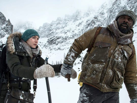 Kate Winslet, left, and Idris Elba in a scene from