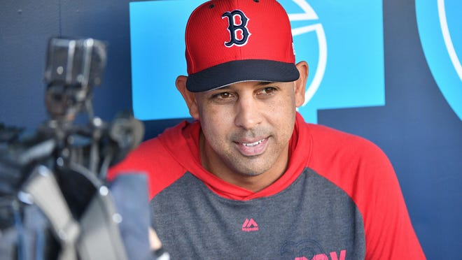 Boston Red Sox manager Alex Cora (20) speaks with media before a game against the Kansas City Royals at Kauffman Stadium on June 5, 2019.