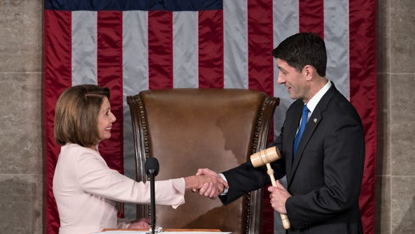 House Speaker Paul Ryan of Wis. shakes hands with House