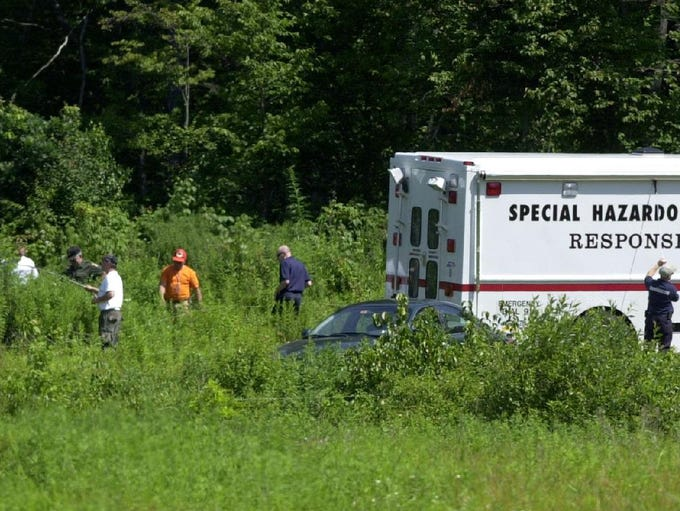 Officials search the area by Felchar Manufacturing
