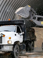 Barney Hill loads city of Murfreesboro trucks with salt on Wednesday, Jan. 20, 2016, to help clear the ice and snow on the roads.