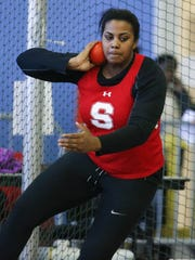 Smyrna's Marissa McFolling-Young throws in competition as she wins the shot put during the DIAA state indoor track championships Saturday in Landover, Md.