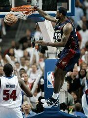 Cleveland Cavaliers' LeBron James slams a dunk home