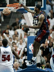 Cleveland Cavaliers' LeBron James slams a dunk home in the fourth quarter of the Eastern Conference Final game vs. the Detroit Pistons on May 31, 2007 in Auburn Hills, Mich.