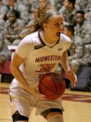 Midwestern State's Mica Schneider drives to the basket