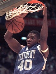 Walter McCarty dunks in the first half of an NCAA Final Four game against Massachusetts, Saturday, March 30, 1996, in East Rutherford, N.J. (AP Photo/Ed Reinke)