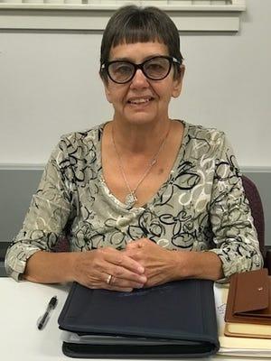 Spring Grove school board member Karen Baum took her seat on the board after being sworn in Monday, Sept. 25, 2017.