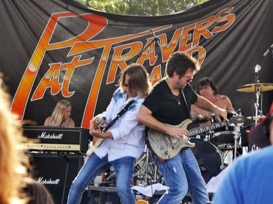 The Pat Travers Band performs during the 2014 80's in the Park music festival at the former Wickham Park Pavilion next to Eastern Florida State College-Melbourne.