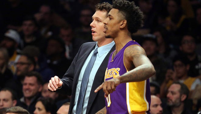 Los Angeles Lakers head coach Luke Walton coaches Los Angeles Lakers shooting guard Nick Young (0) against the Brooklyn Nets during the second quarter at Barclays Center.
