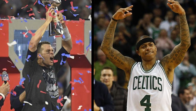 Boston Celtics guard Isaiah Thomas (4) celebrates during the fourth quarter against the Toronto Raptors at TD Garden. Tom Brady celebrates after Super Bowl 51.