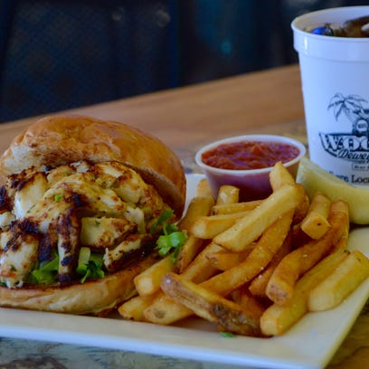 """""""It's the size of  softball,"""" Chip Hearn said of the 10 ounce crab bomb at Jerry's Seafood in Lewes."""