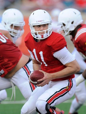 Louisville quarterback Will Gardner (center) looks to hand off the ball on Friday during the 2014 UofL Football Spring game at Papa John's Cardinal Stadium. April 11, 2014