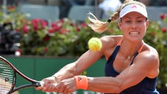 Angelique Kerber of Germany returns a ball to Estonia's