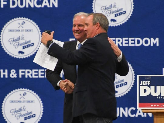 South Carolina Gov. Henry McMaster, left, shakes hands with U.S. Rep. Jeff Duncan while recording video for Facebook Live during his Faith& Freedom barbecue campaign fundraiser at the Civic Center of Anderson on Monday.