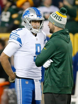 Matthew Stafford talks to Aaron Rodgers before a game Nov. 6, 2017.