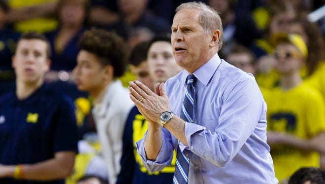 Michigan Wolverines head coach John Beilein reacts from the sidelines in the first half against the Eastern Michigan Eagles at Crisler Center on Tuesday. The Wolverines lost to the Eagles 45-42.