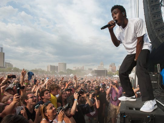 Brockhampton's Merlyn Wood raps to the crowd at the edge of the River Stage on day two of the Mo Pop Festival in Detroit, Sunday, July 29, 2018.