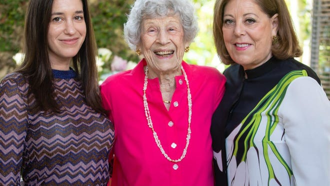 Diane Goldman Levey, center, celebrates her 100th birthday with her granddaughter Amanda Lebow Distenfeld, left, and daughter Patricia Lebow.