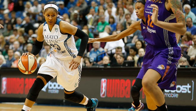 Minnesota Lynx forward Maya Moore drives the ball around the defense of Phoenix Mercury during the first half of Game 1 of the WNBA basketball Western Conference finals.