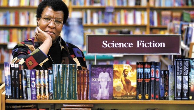 Science Fiction writer Octavia E. Butler poses for a photograph near some of her novels at University Book Store in Seattle, Wash., on Feb. 4, 2004. Marquette University scholar Gerry Canavan's new critical study explores how Butler became a leading American writer.