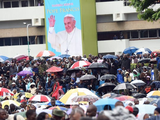 The faithful attend a mass by Pope Francis at a university