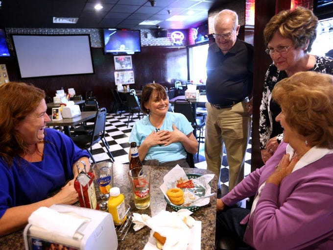 "From left, Karla Kinderman, Lisa Kinderman, Alan and Beverlie Hauss, and Doris Kinderman Straub socialize at Check's Cafe in Louisville's Schnitzelburg neighborhood.  Sep. 24, 2014. All have strong ties to the neighborhood. ""My husband said he graduated from the University of Check's,"" joked Lisa Kinderman. Check's holds a special place in the heart of Karla Kinderman--her mother requested that after her death that Check's be the place that her loved ones convene, and they did."