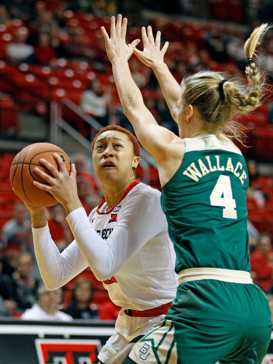 Texas Tech's Brielle Blaire (00) looks to shoot the ball around Baylor's Kristy Wallace (4) during the first half of an NCAA college basketball game Saturday, Feb. 3, 2018, in Lubbock, Texas. (AP Photo/Brad Tollefson)
