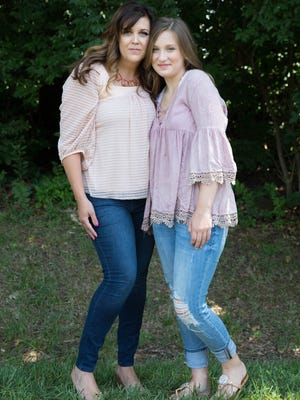 Mother April Perry and daughter Ava Perry coordinate wearing jeans and light pink tops for a casual but classy look. July 25, 2017.