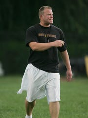 Dan Sabella talks to his players as head coach of Bogota during the 7 on 7 game versus Pope John on Aug. 3, 2006.