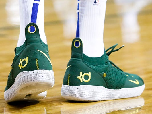 Kevin Durant returned to Seattle wearing a Sonics jersey aa1b31f90