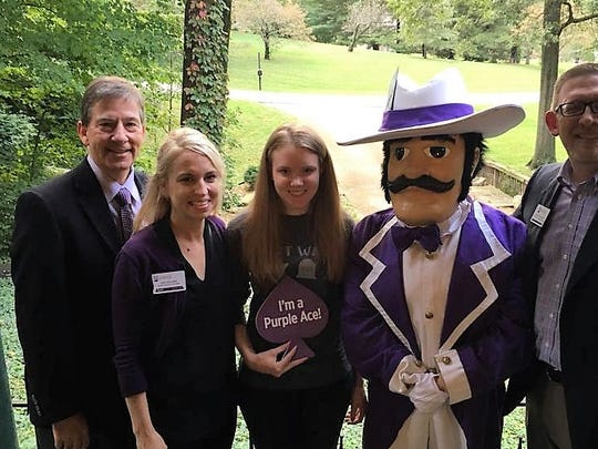 UE ACCEPTANCE – Signature School senior Darcie Smith was hand delivered her acceptance package to the University of Evansville at her Newburgh home by President, Dr. Tom Kazee, Senior Admission Counselor Heather Cook, ACE Purple and Vice President Dr. Shane Davidson.  Now that is what we call making a nice house call!