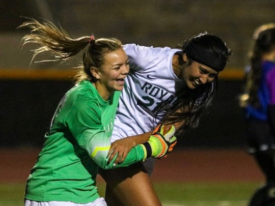 Marissa Froio and Hamneet Grewal, Royal High's only two seniors, celebrate the Highlanders' unbeaten Coastal Canyon League season after edging rival Simi Valley 2-1 in overtime on Wednesday.