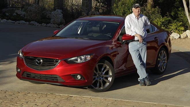 Test Drive columnist James R. Healey with the 2014 Mazda6 somewhere in Texas Hill Country following a sprited drive on the winding back roads.