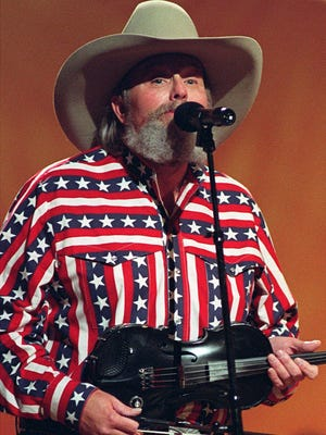 """FILE - Singer Charlie Daniels performs in Nashville, Tenn., on May 7, 1992. Daniels, who had a hit with """"Devil Went Down to Georgia"""" has died at age 83. A statement from his publicist said the Country Music Hall of Famer died Monday due to a hemorrhagic stroke."""