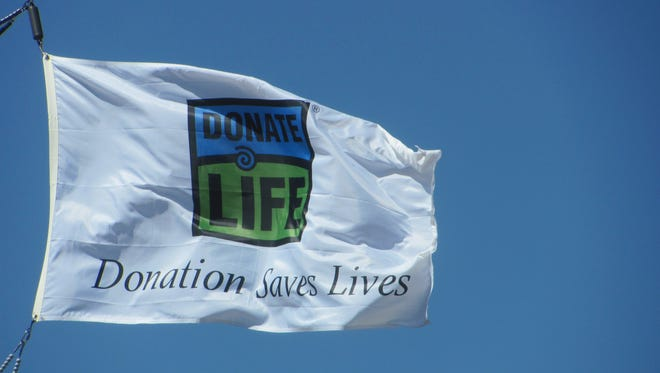 "A ""Donate Life"" flag flies above the north entrance to Dixie Regional Medical Center as a reminder of the people who benefit from organ donation."