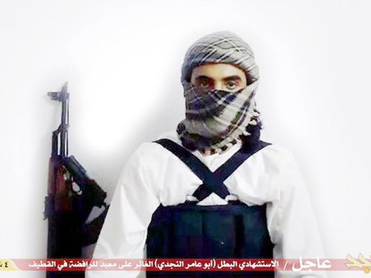 "Militant photo via AP, FILE FILE - This file image taken from a militant website associated with Islamic State extremists, posted Saturday, May 23, 2015, purports to show a suicide bomber,  with the Arabic bar below reading: ""Urgent: The heroic martyr Abu Amer al-Najdi, the attacker of the (Shiite) temple in Qatif"",  which the Islamic State group's radio station claimed responsibility for."