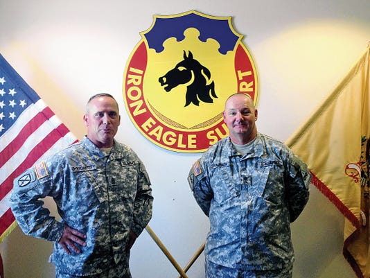 Command Sgt. Maj. Lawrence Dougherty, left, and Sgt. Maj. Mark W. Grumbach, both with the 127th Aviation Support Battalion, plan to retire.